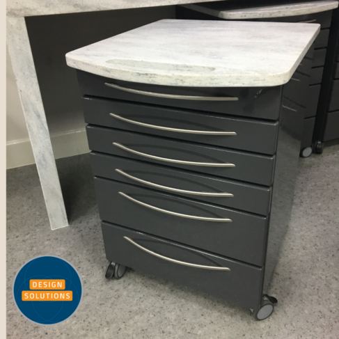 A Dental Mobile Cabinet in charcoal grey fronts and corian tops