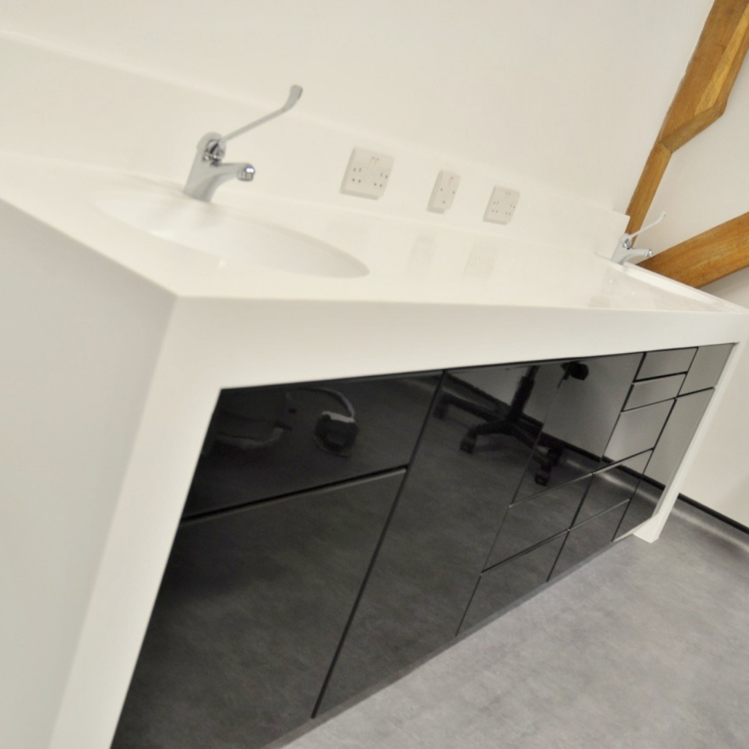 FAT Modern Dental Cabinetry with black gloss doors and white corian tops