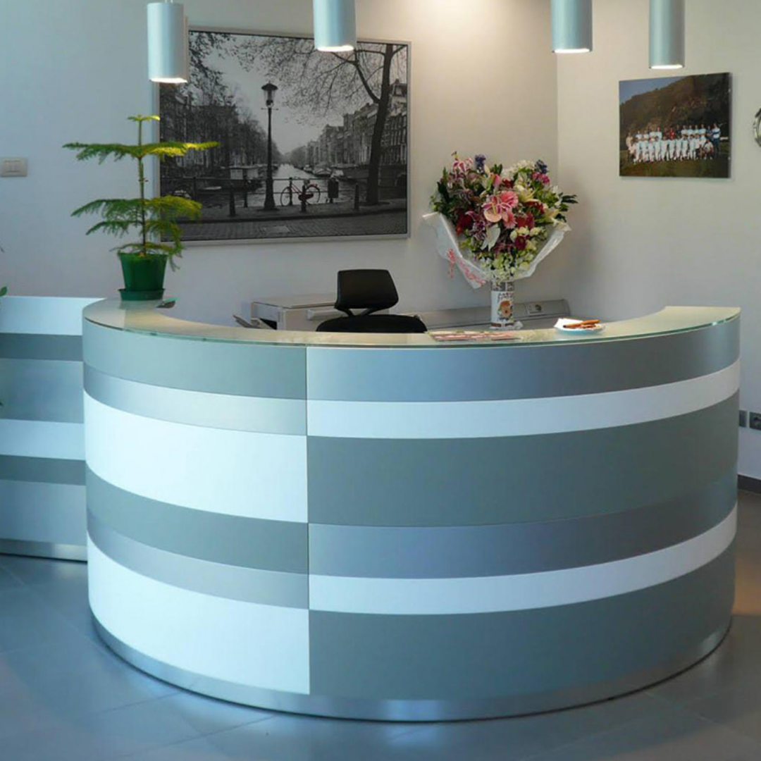 he Twist Reception Desk using two curved sections and a seperate matching panel