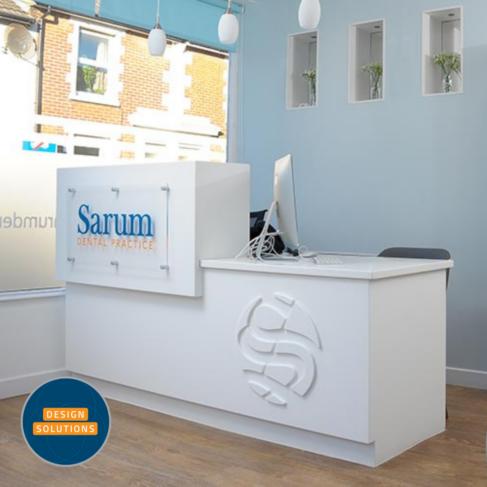 Bespoke Dental Reception Desk with Corian inlayed logo